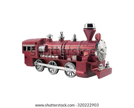 Isolated toy train angle view. Isolated old fashioned red toy train angle view with metal elements.