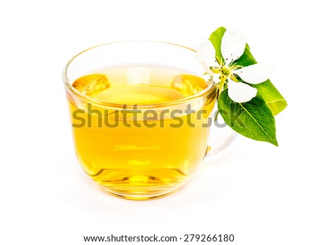 isolated transparent cup of apple juice and flower