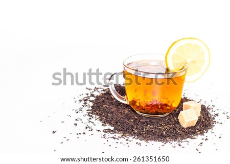isolated transparent cup of tea and lemon - stock photo