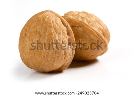 Isolated two walnuts on white background - stock photo