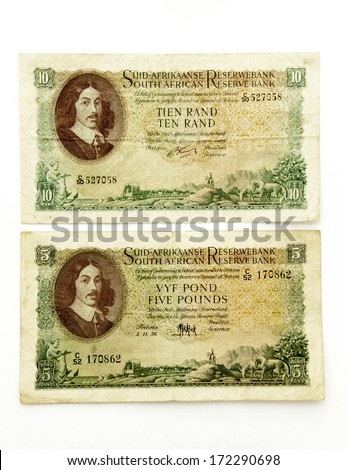 isolated Union of South Africa 5 pound bank note and Republic of South Africa 10 Rand banknote - stock photo