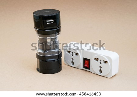 Isolated universal adaptor with plug socket for travelling