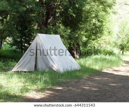 Isolated vintage canvas tent on dirt road. & Vintage Tent Stock Images Royalty-Free Images u0026 Vectors ...