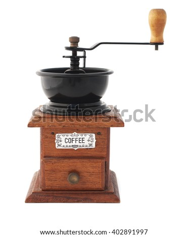 Isolated vintage wooden coffee grinder on a white background.