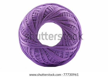 Isolated violet cotton spool against white background