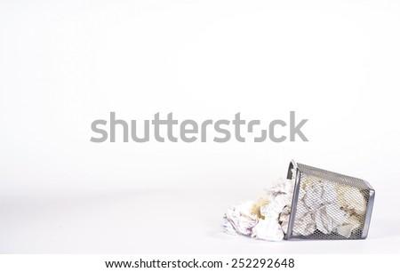 isolated wastebasket full of white waste paper - stock photo