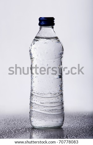 Isolated water bottle with water drops - stock photo