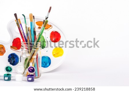 isolated water paint and paints brushes in a glass - stock photo