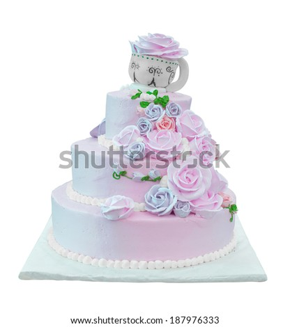 isolated wedding cake with cup and rose shaped decoration