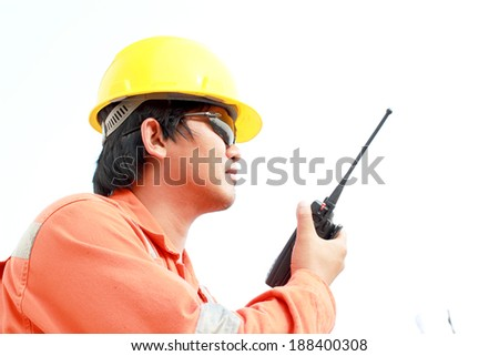 isolated white background. man communicating on walkie-talkie at site  - stock photo