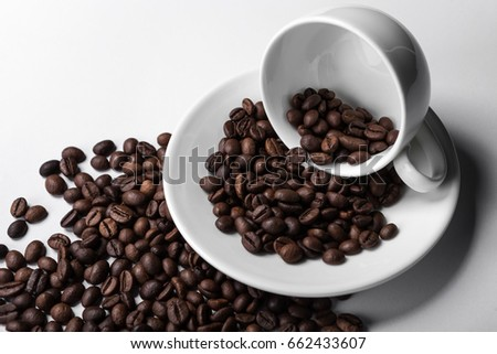 isolated white cup with coffee grain on table. background for design