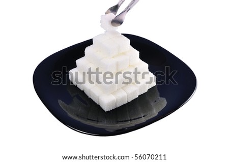 isolated white sugar pyramid on a plate - stock photo
