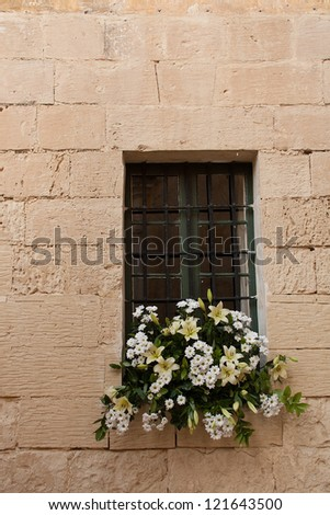Isolated window with large bouquet of white and yellow flowers in the window sill