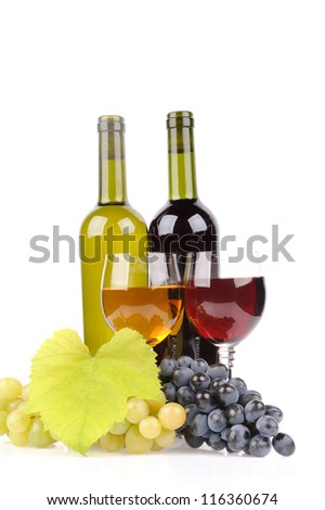 isolated wine bottle with glass and green grapes - stock photo