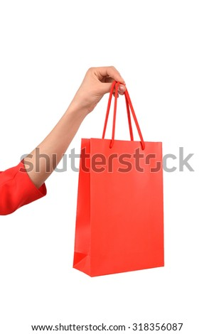 Isolated woman hand carries a shopping bag