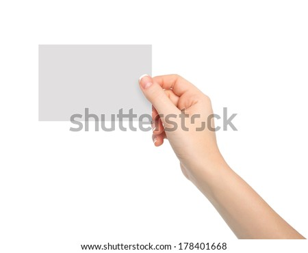 isolated woman hand holding a piece of paper - stock photo