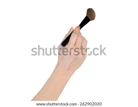 Isolated woman hand holding makeup brush - stock photo