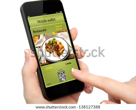 isolated woman hand holding the phone touch with a mobile wallet and ticket discount in restaurant - stock photo