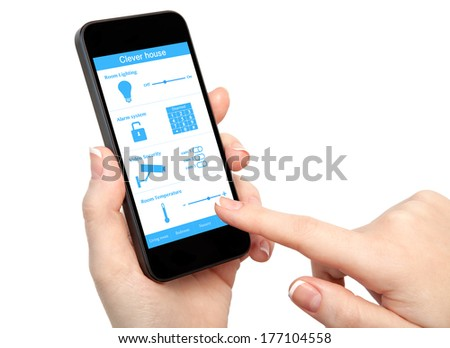 isolated woman hand holding the phone with system clever house - stock photo