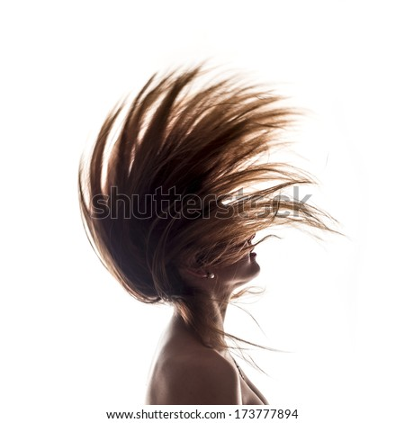 Isolated woman portrait side view in back light with hair in the wind