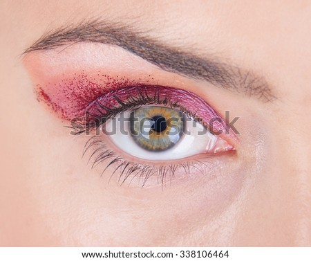 Isolated woman's eye with makeup
