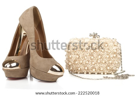 isolated women beige suede shoes with clutch bag - stock photo