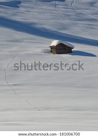 Isolated wood mountain house cabin hut covered by snow