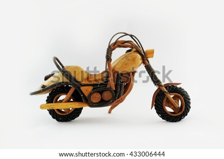 isolated wooden chopper or motorbike or motorcycle place on white background and ready dream to travel or adventure to anywhere on the earth  - stock photo