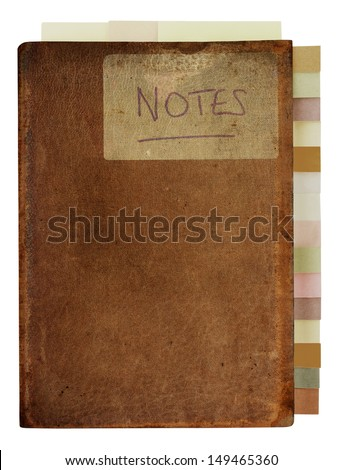 Isolated worn, marked and stained, old brown leather notebook, labeled with the word 'Notes'.  Tabbed index down right side in muted colours, and three bookmark tabs poking out along the top edge. - stock photo