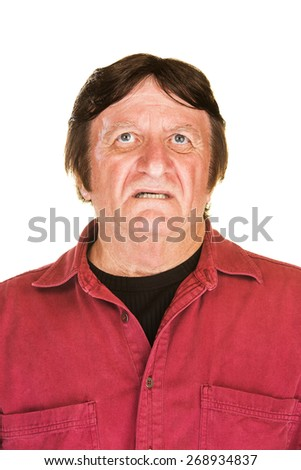 Isolated worried middle aged man looking up