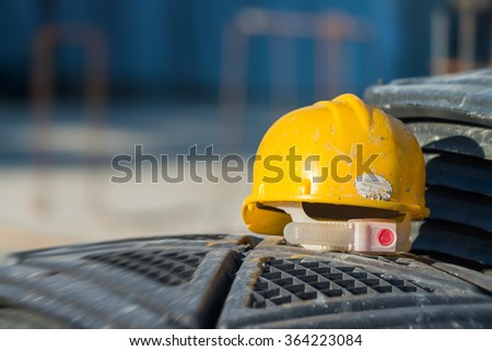 Isolated yellow worker hard-hat,natural light in construction site. - stock photo