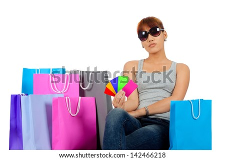 Isolated Yong Asian Woman With colorful Shopping Bags - stock photo