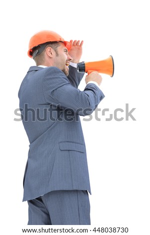 Isolated young architect with megaphone - stock photo