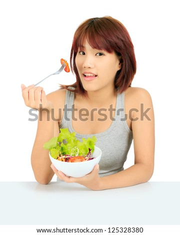 Isolated young asian girl with a bowl of salad