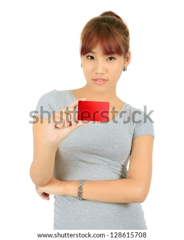 Isolated Young Asian Woman With a Credit Card - stock photo