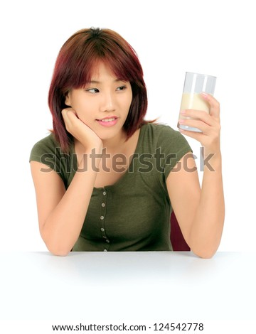 Isolated young asian woman with a glass of milk