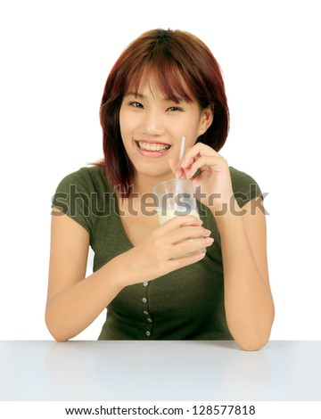 Isolated young asian woman with a glass of milk - stock photo