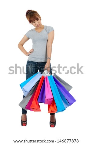 Isolated young Asian woman with colorful sopping bags - stock photo