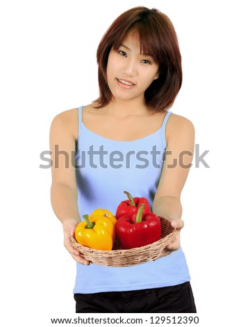 Isolated young asian woman with paprika on white