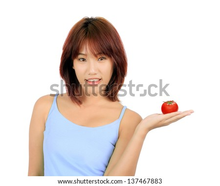 Isolated young asian woman with tomato on white