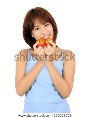 Isolated young asian woman with tomatoes on white