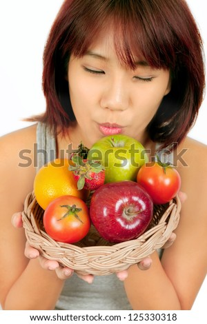 Isolated young asian woman with various fruits