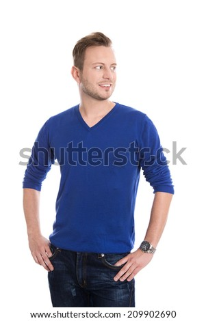 Isolated young blond man in blue pullover looking sideways to text. - stock photo