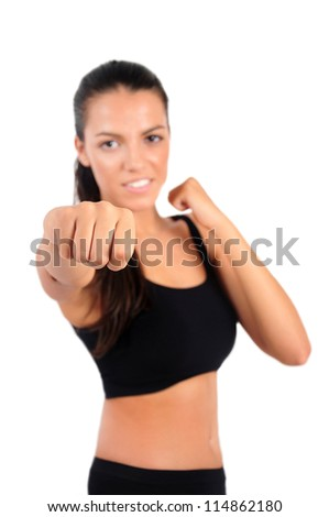 Isolated young boxer woman with focus on punch - stock photo