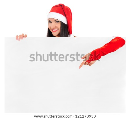 Isolated young brunette christmas girl showing empty paper