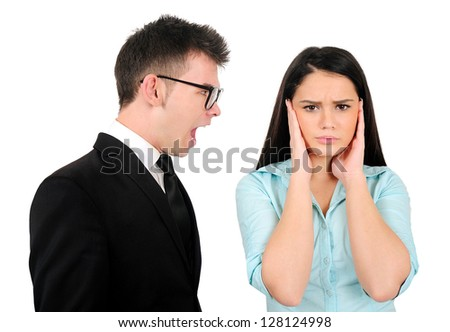 Isolated young business couple argue - stock photo