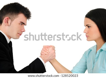 Isolated young business couple arm wrestling