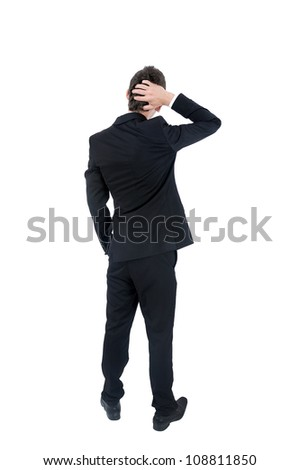 Isolated young business man confused - stock photo