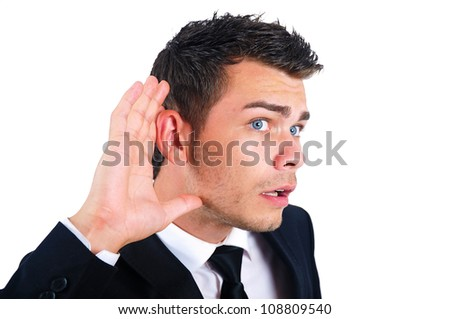 Isolated young business man listening - stock photo