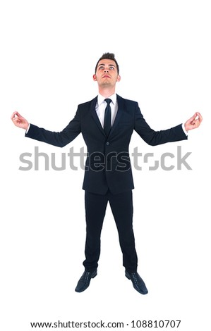 Isolated young business man meditation